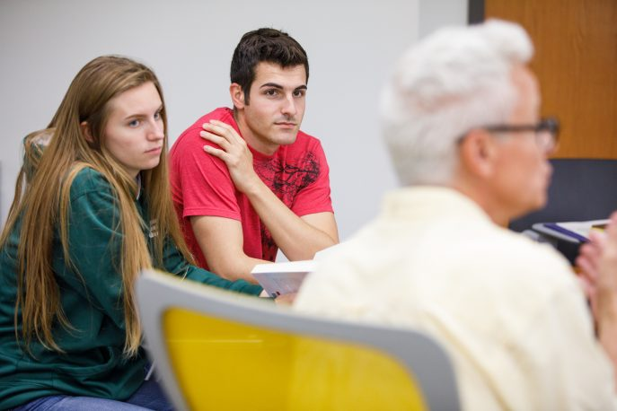 Students participating in a classroom discussion.