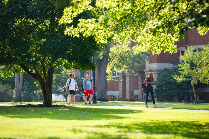 Students walking across Albion College campus