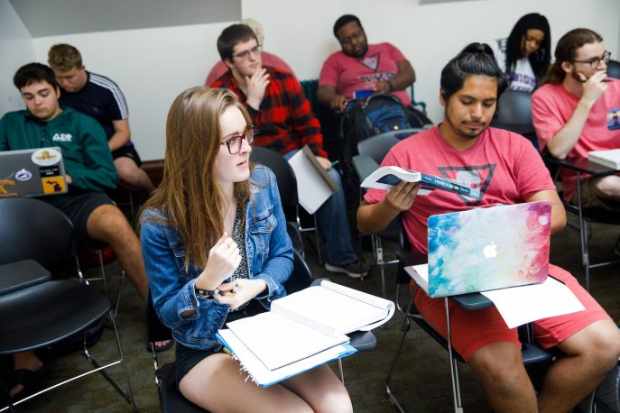 Albion students listening to a lecture in a classroom setting.