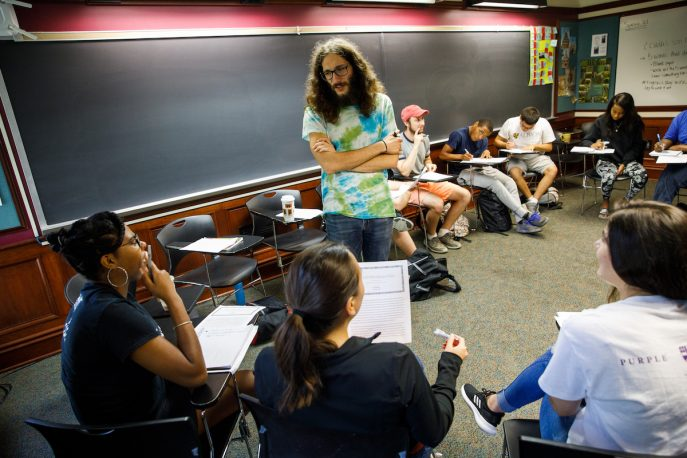 Albion College students participating in a discussion in a classroom