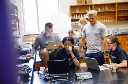 Group of Albion College students working together in a lab