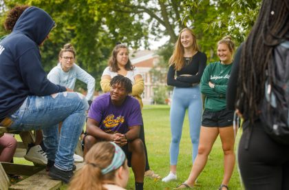 Group of Albion College students outside talking on campus