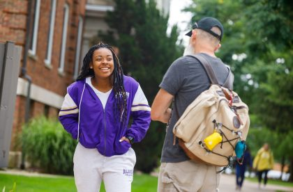 Albion College community members talking with one another on campus