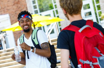 Two Albion students talking and laughing outside.