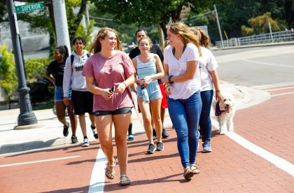 Group of Albion College students walking through downtown Albion.