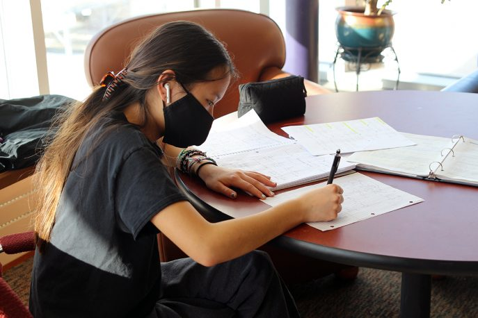 Albion College student working at a table