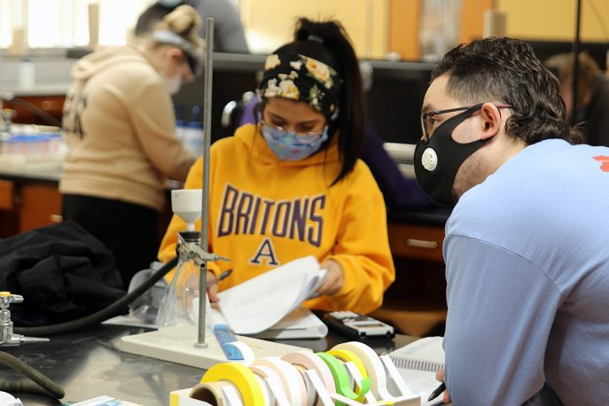Two Albion College students working together in a lab
