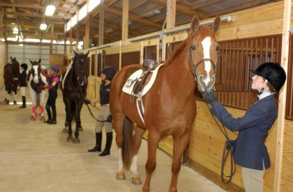 Albion College students at the Held Equestrian Center.