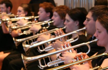 Group of students playing brass instruments.