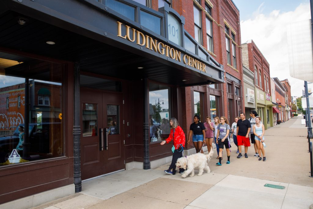 Students approach the Ludington Center in downtown Albion.