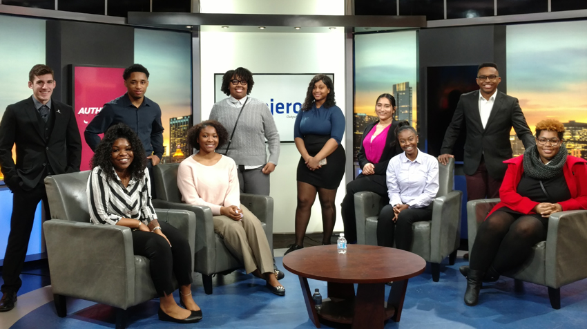 Students on the set of a television show, as a part of a field trip to Chicago with the Career and Internship Center