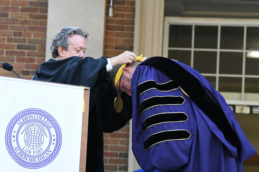 Michael Harrington, '85, and Dr. Mathew Johnson