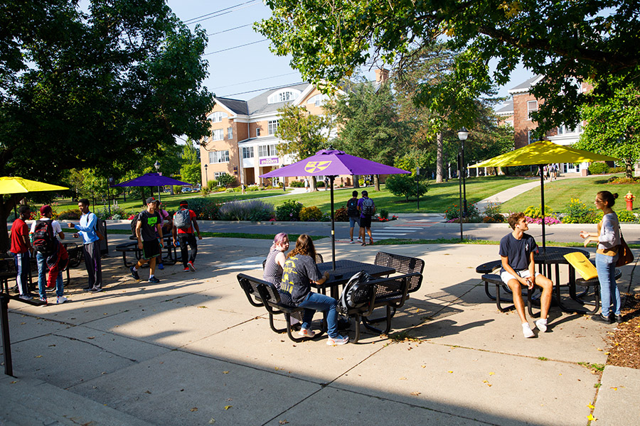 Albion College students outside Baldwin Hall.
